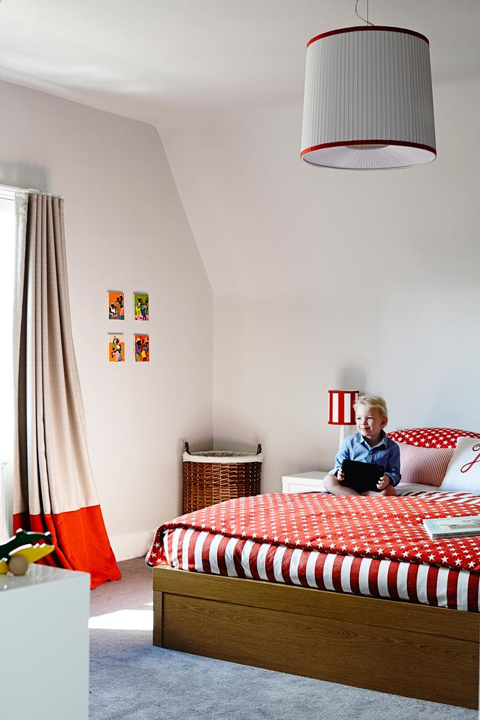 Jo's boys have individual accent colours for their bedrooms: this room has a red theme while the other features blue hues.