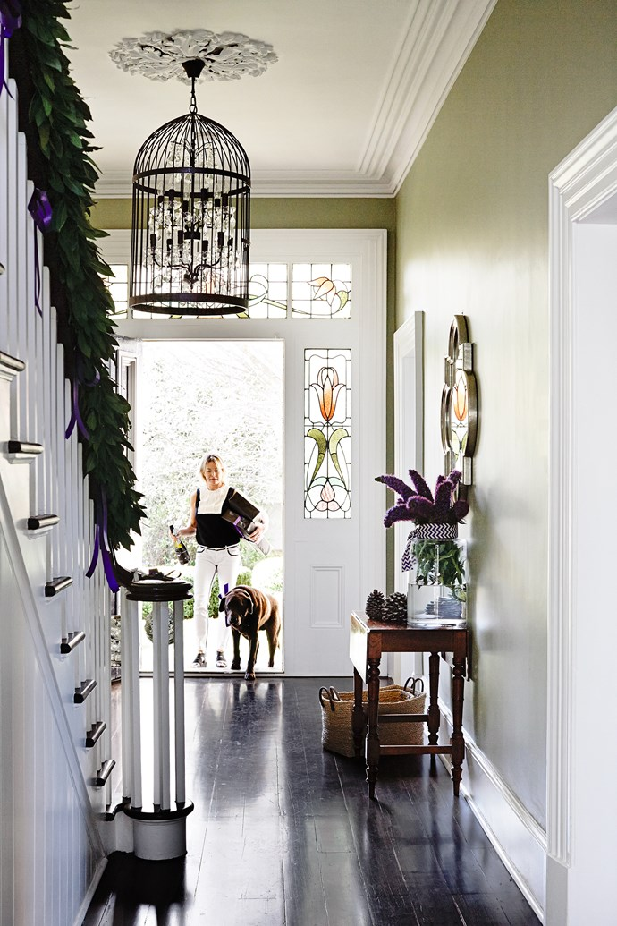 """A mahogany staircase is one of the 19th-century home's standout original features. The floorboards have been refinished in a blend of wenge and black japan stains. """"Our inspiration for the hallway colour came from the leadlight windows,"""" says Jo."""