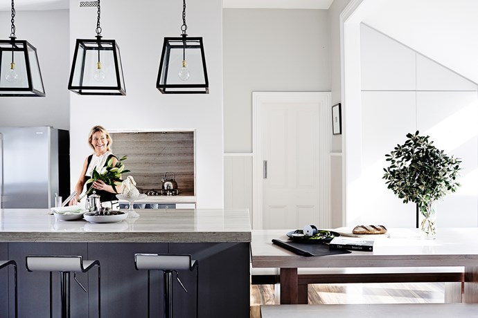 """Just off the kitchen is a beautiful sunroom that delivers sunlight into the rear of the house. """"The new kitchen has completely changed the way we entertain,"""" says Jo. """"It's so easy, with a minimum of fuss."""""""