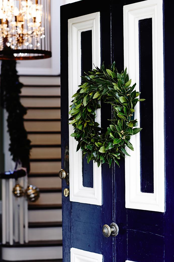 A lush wreath on the front door invites guests to get into the [Christmas spirit](http://www.homestolove.com.au/stylish-and-simple-christmas-decorating-ideas-2553).