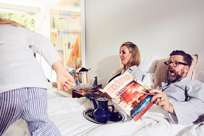 """I find that it's lovely family time before the busy day starts,"" Michelle says of early mornings. ""The kids come into our bed – lots of cuddles first thing."" Michelle and Tim are wearing The Pyjamas sleepwear by [My General Store](http://www.mygeneral-store.com/