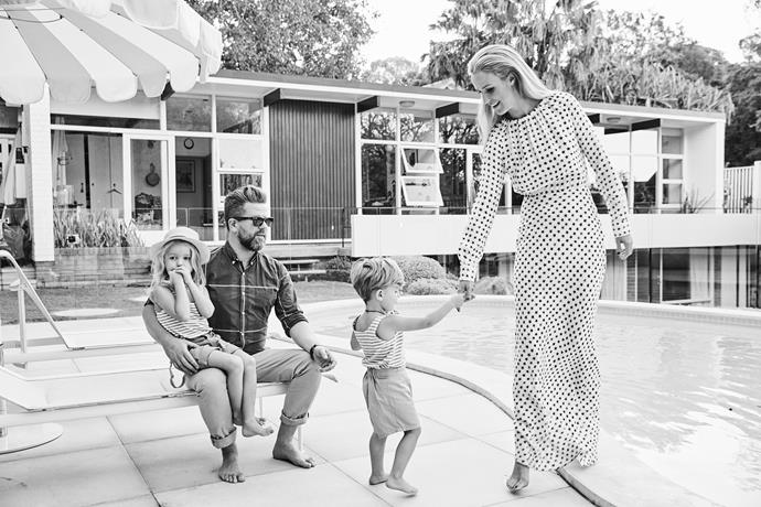 Tim Ross at his mid-century style home with wife Michelle and sons Bugsy and Bobby.
