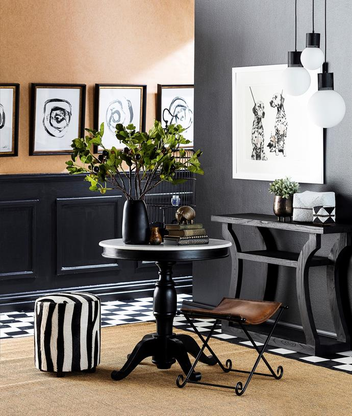 """Aim for quirky and cool interiors by using multi-purpose and flexible furniture. Opting for a few occasional tables over a large coffee table creates different opportunities to style a space. In this foyer, furniture is mixed and matched with the [black and white scheme](http://www.homestolove.com.au/shop-the-look-black-and-white-decorating-3895 target=""""_blank"""") tying everything together. *Photo: Maree Homer*"""