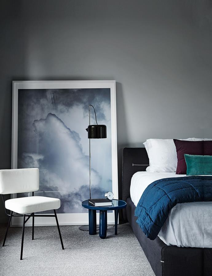 """Another fresh trend for spring is asymmetry. In this [bedroom retreat](http://www.homestolove.com.au/how-to-create-a-bedroom-retreat-3771 target=""""_blank""""), the chair, artwork, lamp and beside table all sit at different levels, adding dimensions to the space. *Photo: Sharyn Cairns*"""