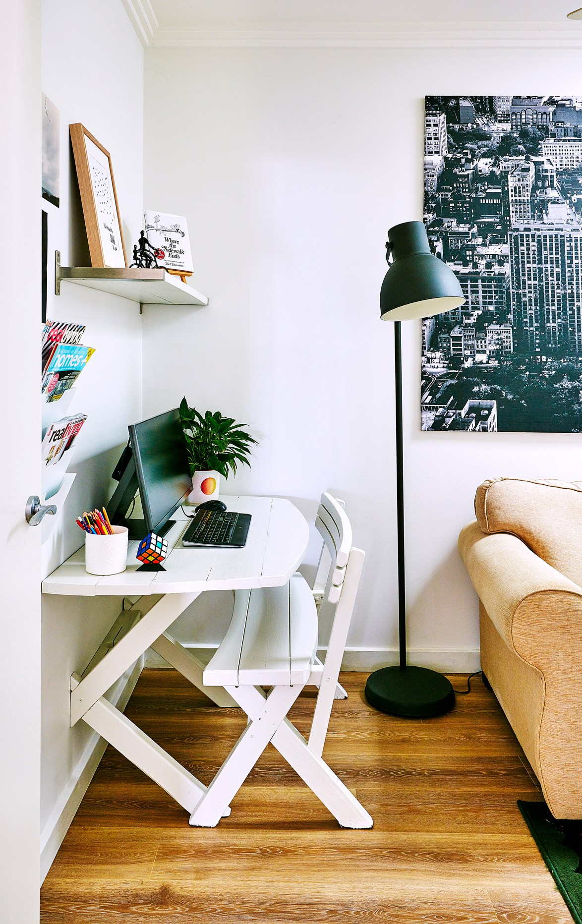 """A quaint and practical work space has been set up in this [eclectic family home](https://www.homestolove.com.au/this-eclectic-country-home-has-family-at-its-heart-4003 target=""""_blank"""") by sawing a picnic bench in half and mounting it to the wall. *Photo:* Scott Hawkins"""