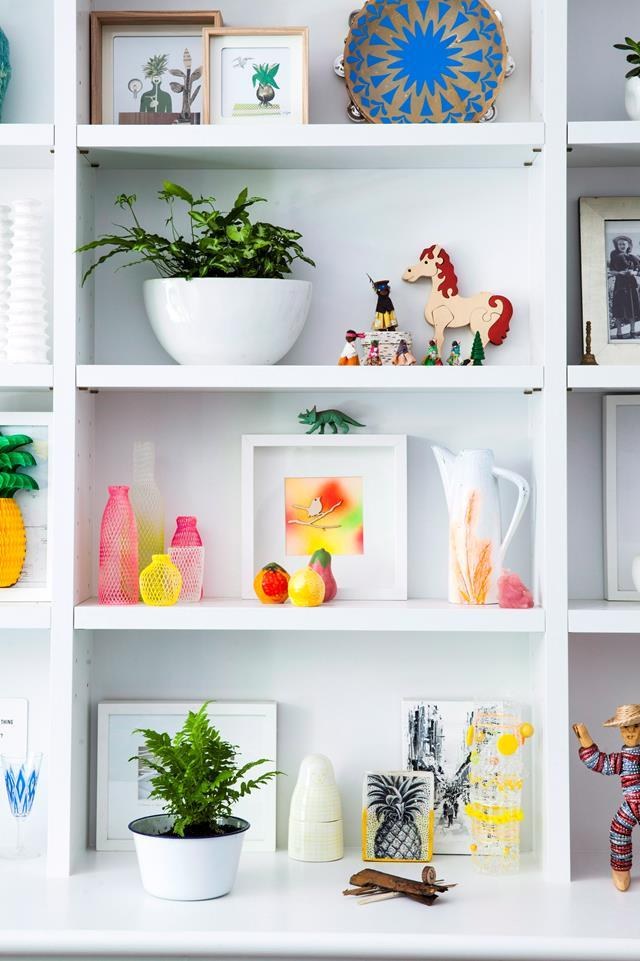 """Stacking houseplants in shelving with other bits and bobs is a great way of displaying personal, sentimental items. [In this hallway](http://www.homestolove.com.au/how-to-decorate-a-large-entry-hall-3804