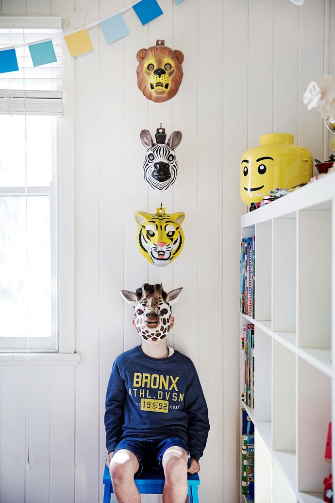 Animal masks purchased off eBay are an affordable wall art solution for kids rooms and nurseries.