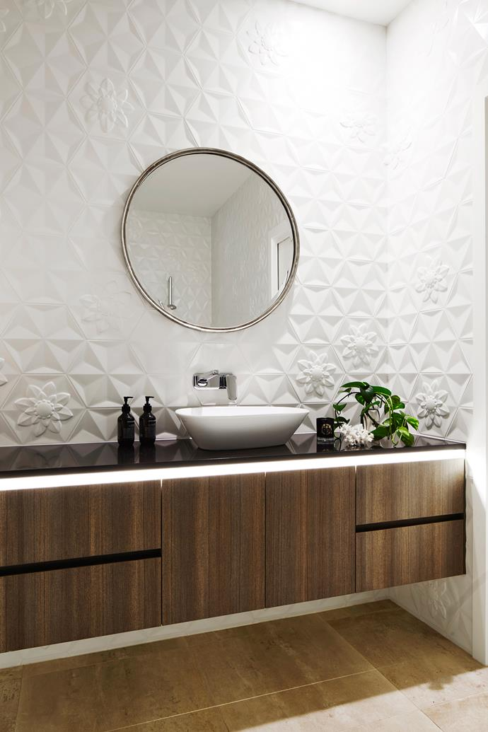 Three-dimensional wall tiles are an extra-special feature in the guest bathroom.