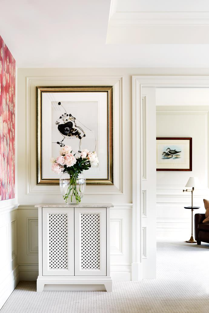 A John Olsen artwork in 'her' study hangs near a panelled sliding door that can separate the studies. Framed print by John Gould.