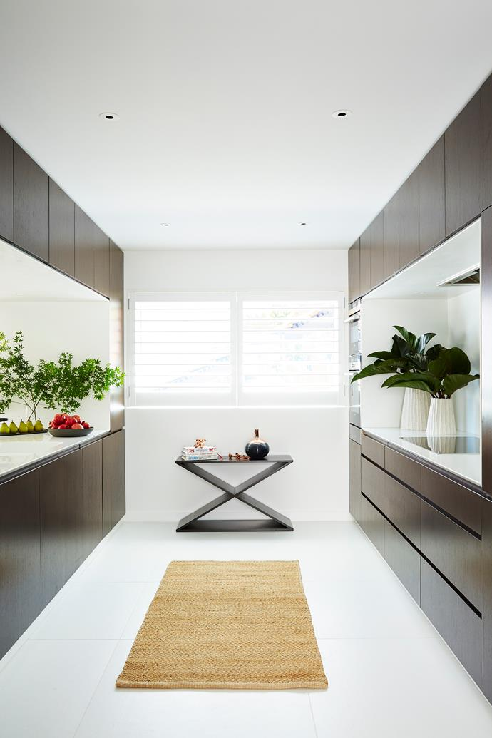 """The kitchen is designed as two pods; one for cooking, the other for cleaning and prep. X table, designed by Poppy and made by [Featherwood Furniture](http://featherwood.com.au/