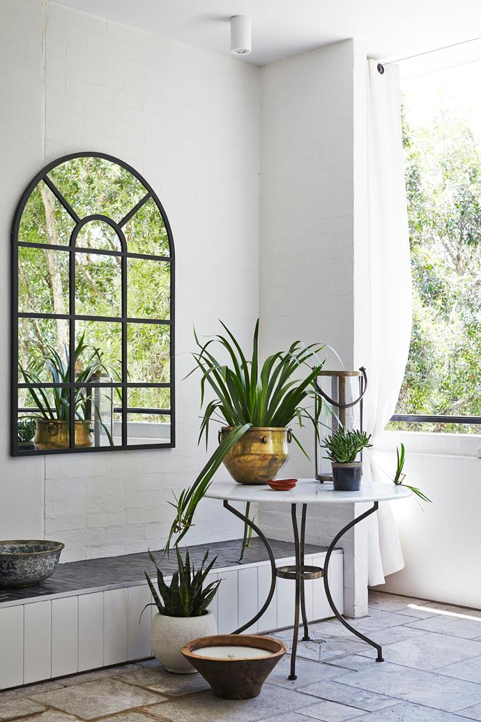 Great idea: Double up on plants with a mirror.