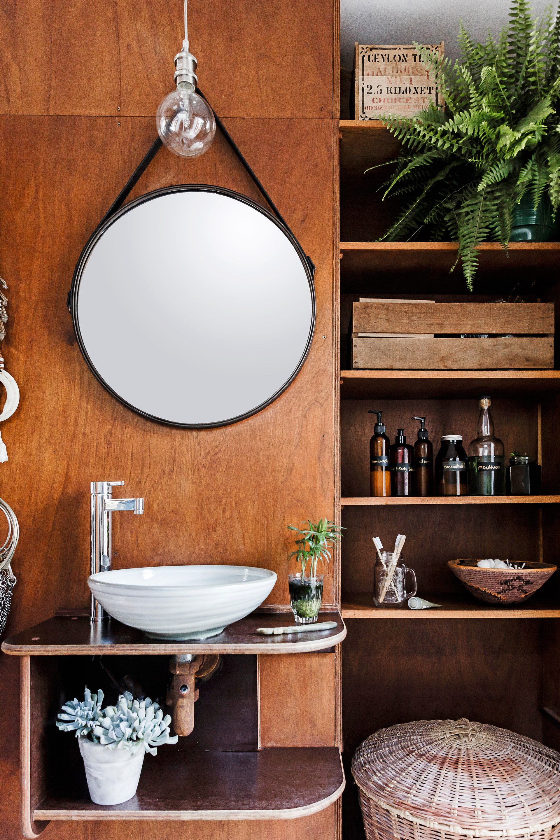 Whichever room you decorate, catch yourself before you fall for the default option. You don't have to use tiles in the bathroom. You don't have to use a traditional vanity. Consider alternative finishes such as timber and eclectic second-hand finds to create a rustic, coastal bathroom. *Photo: Maree Homer*