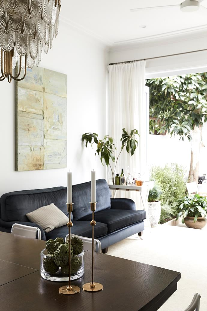 """Bringing a sophisticated wash of colour to the living room is a custom-made sofa from [Natasha Levak](http://natashalevak.com/