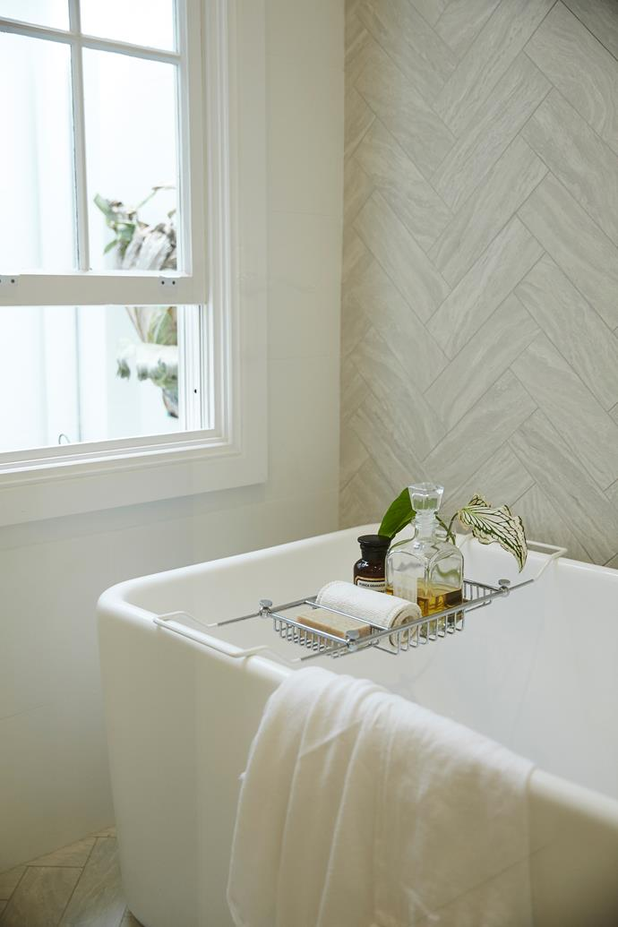 """The bathroom features faux-marble porcelain tiles, from [Academy Tiles](http://www.academytiles.com.au/