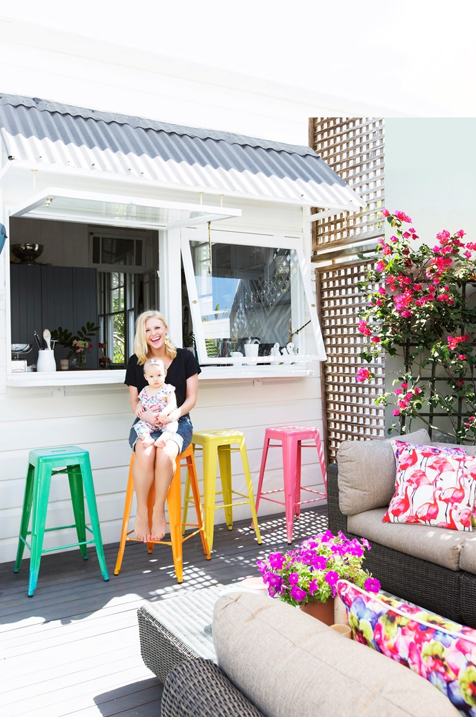 """With servery windows opening out from the kitchen, the deck is a much-used space. The colourful stools are from [Matt Blatt](http://www.mattblatt.com.au/