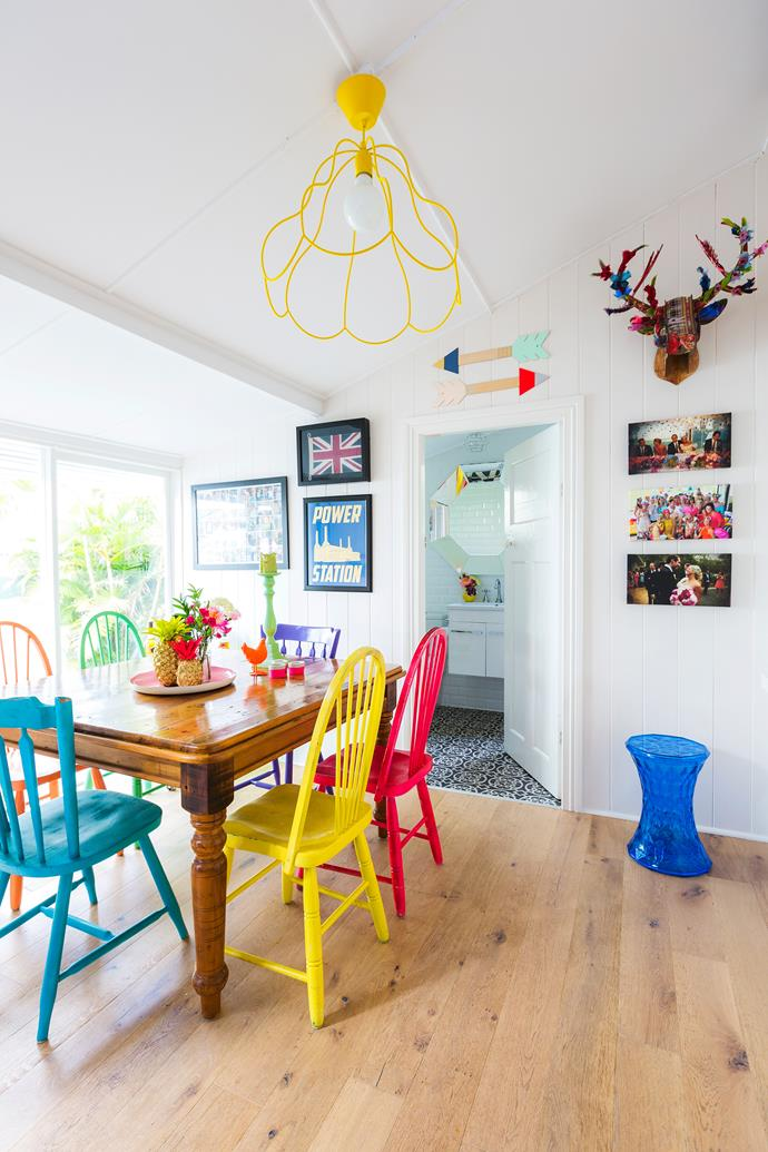 "As a ""crazy nesting project"", Stephanie spray-painted the dining chairs she'd kept from her childhood in bold colours."