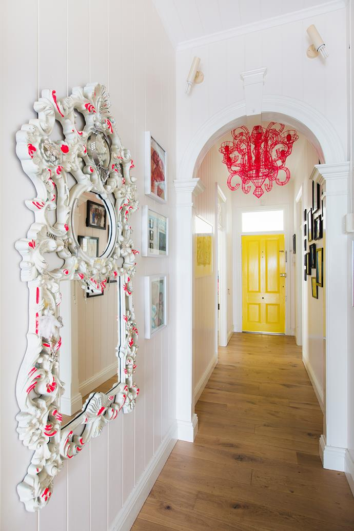 With its pink chandelier and ornate mirror, the entrance hall is cheery and eclectic.