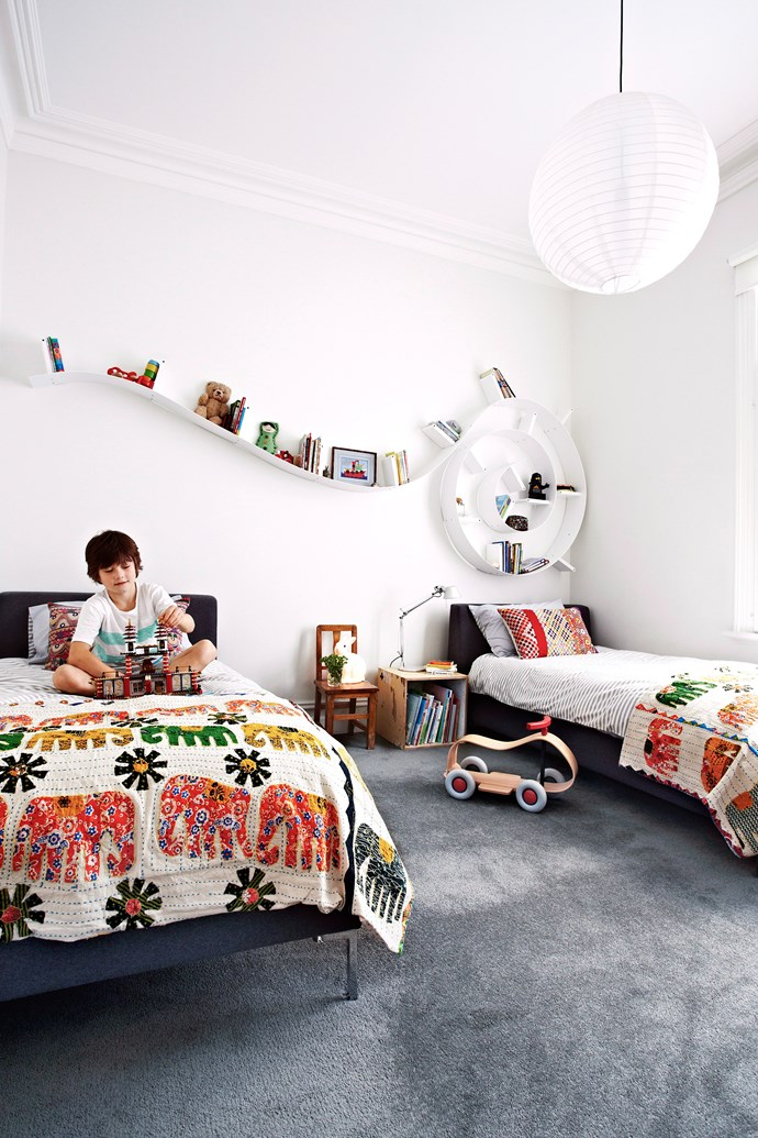 Kids' bookshelves don't have to be boring. Make them a focal point by choosing shelves in unusual shapes and displaying books, toys and pictures for functional and decorative appeal. Photo: Maree Homer / bauersyndication.com.au