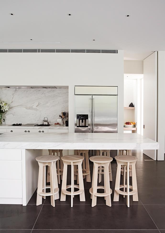 Opt for durable and easy to clean materials such as stone finishes  for benchtops and splashbacks so you can spend less time worrying about the mess and more time enjoying yourself. A marble finish is a great alternative if you're looking to add texture and style. *Photo: Tim James / bauersyndication.com.au*
