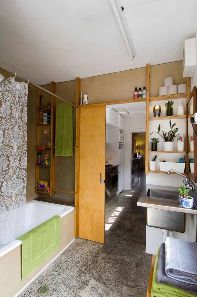 **Fill every nook and cranny.** A bespoke shelving unit can help you make the most out of a tiny space. Take lead from this home's inspired storage solution and store all the way to the ceiling. *Photo: Simon Kenny / bauersyndication.com.au*
