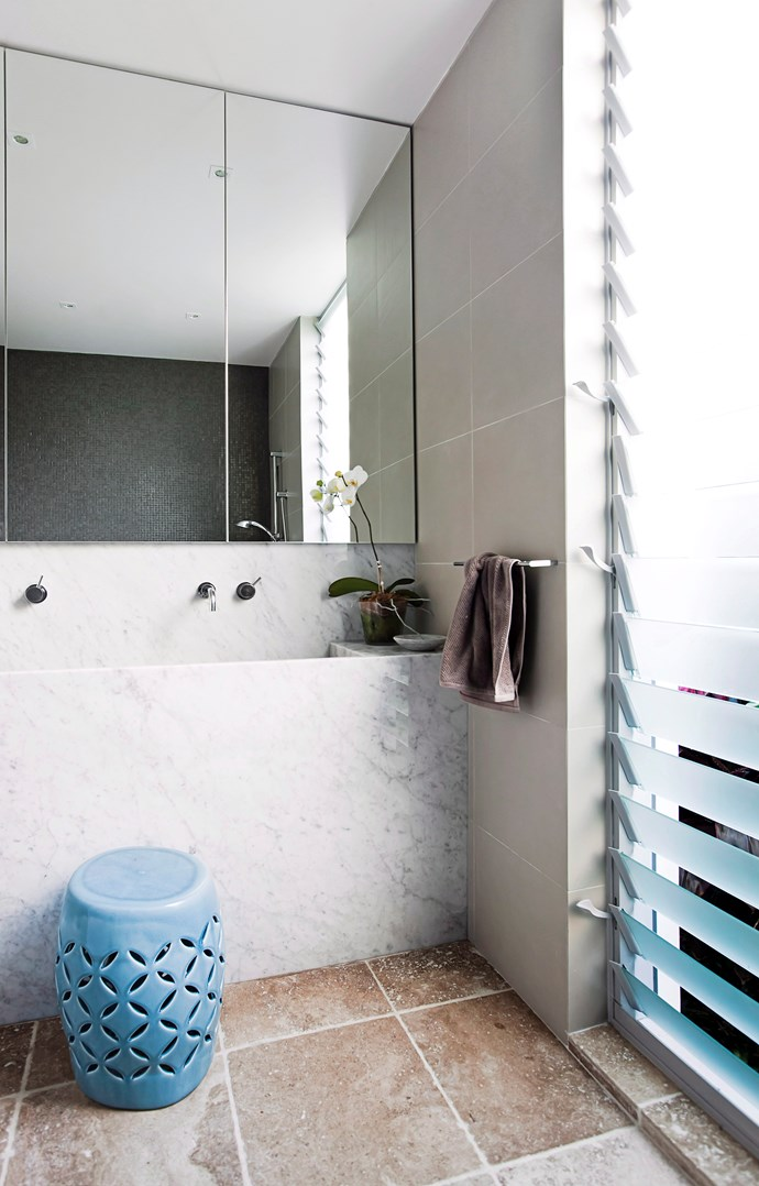 **A head-to-toe solution.** Natural light beams through this floor-to-ceiling louvre window making a smaller bathroom feel so much brighter and more spacious. A great trick to employ in a small space. *Photo: Maree Homer / bauersyndication.com.au*
