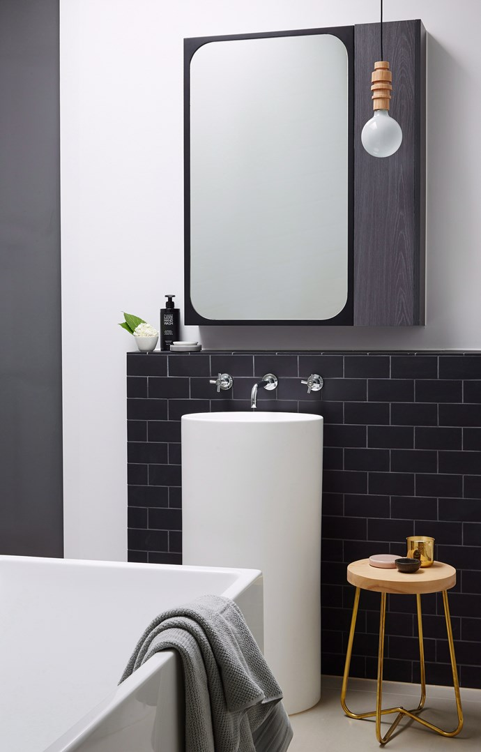 **Round it out.** Sharp edges aren't the most friendly in tight spaces. Opt for softer finishes in a rounded wall basin or curved bath. They'll feel less intrusive and will help you avoid any painful middle-of-the-night bumps. *Photo: Sean Fennessy / bauersyndication.com.au*