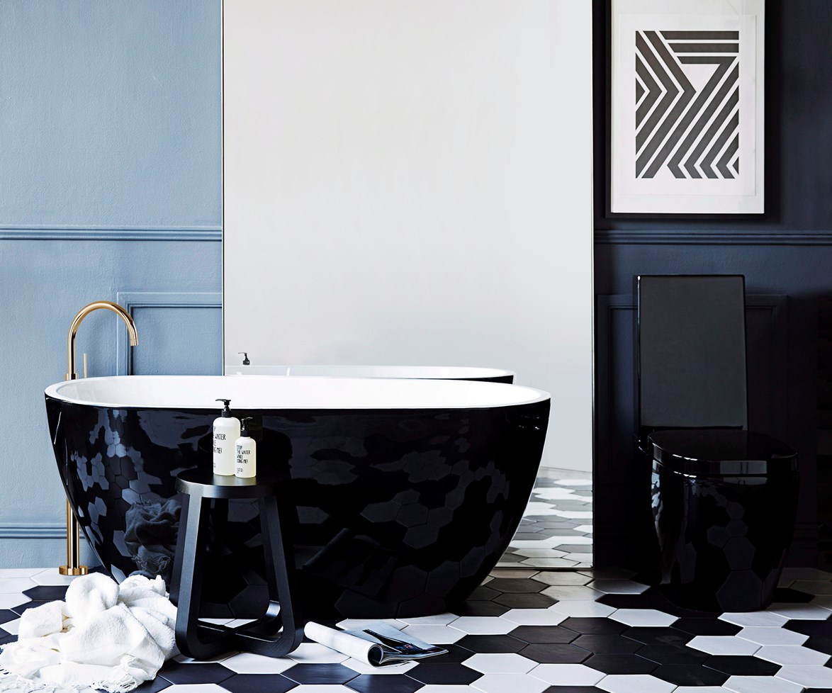 """For [Deco-inspired](http://www.homestolove.com.au/modern-art-deco-style-4254 target=""""_blank"""") luxe, view the world in black and white. This classic combo never goes out of fashion – it creates instant graphic impact. Play it up by confining your palette or play it down by adding more muted tones, such as the blue wall in this [glam bathroom](http://www.homestolove.com.au/expert-advice-bathroom-design-tips-4073  target=""""_blank""""). *Photo: Chris Warnes / real living*"""