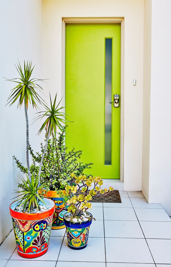 A grouping of pots, teamed with a bold front door, makes a striking entrance. Photo: bauersyndication.com.au