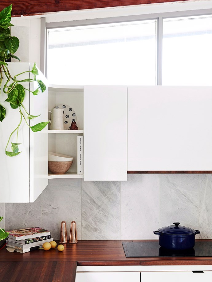 "Minimal doesn't mean boring! The [kitchen](http://www.homestolove.com.au/the-best-real-living-kitchens-3920|target=""_blank"") is the perfect place to explore different finishes and materials such as timber, stone and matte or gloss cabinetry – when combined, they add an extra dimension. A touch of greenery helps to bring life to minimal design."