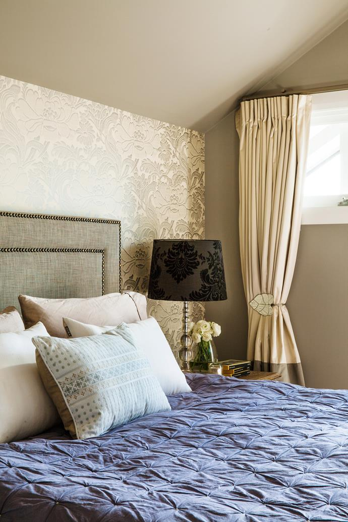 "Lush textiles abound in the main bedroom, from the tactile bedlinen to the Florence Broadhurst Tudor Floral wallpaper and the studded bedhead in Villa Nova Malmo Soft in Mineral from [Marco Fabrics](http://www.marcofabrics.com.au/|target=""_blank""