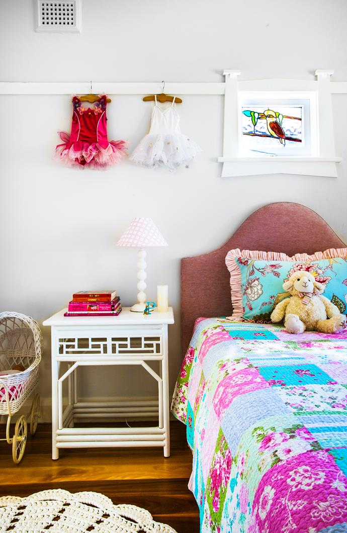 "Original features, such as the classic kookaburra stained-glass window in this bedroom, have been incorporated into new decor. The bedside table is from [Sasson Home](http://www.canvasandsasson.com.au/|target=""_blank""