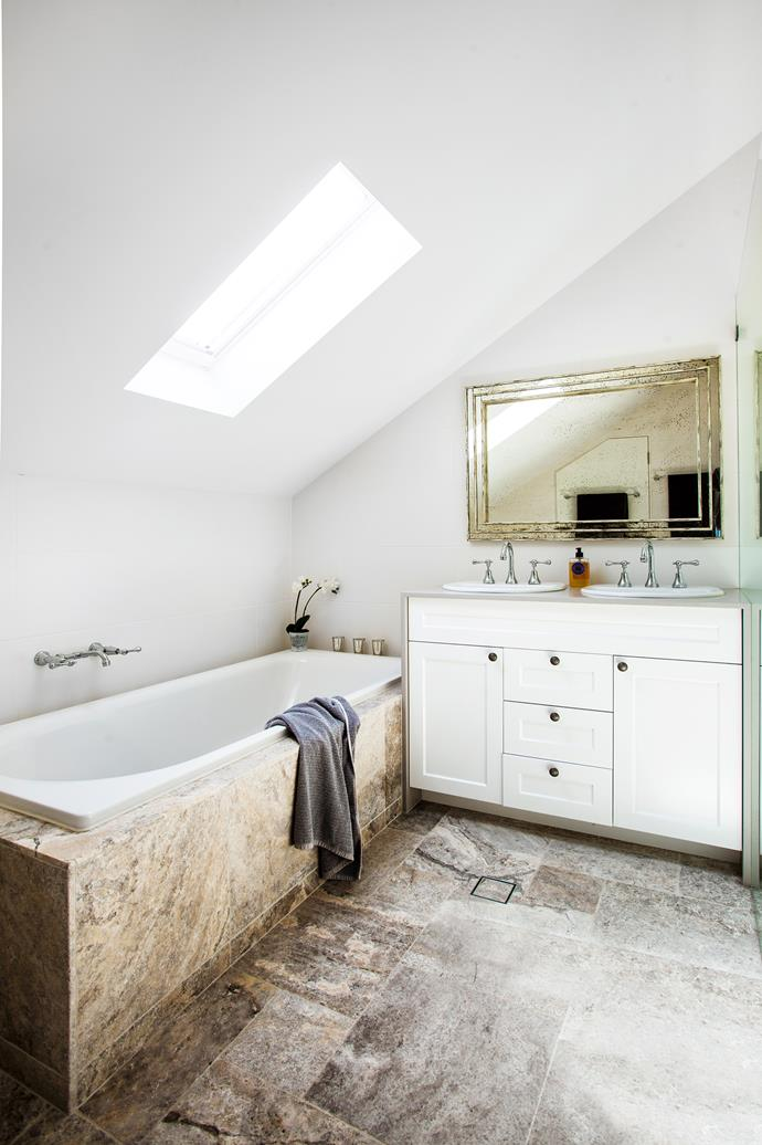 Silver travertine tiles were chosen for their beautiful mixed-grey shades. For visual impact, the tiles have been cut in a variety of dimensions and laid in a traditional French style.