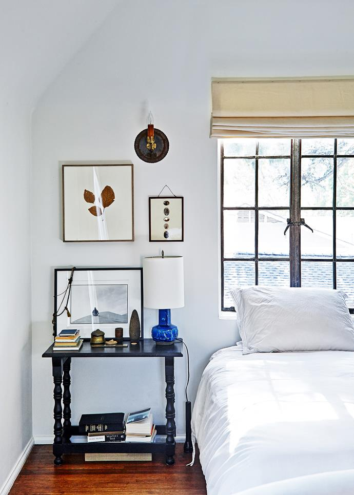 A small antique console table makes a perfect bedside table. Nature is an ongoing theme in the bedroom; organic artworks add to the relaxed feel.