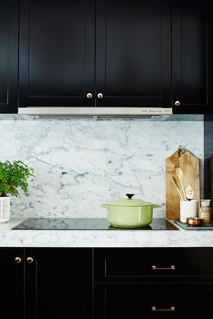 """Two-pack polyurethane **cabinetry** in a black satin finish by E&A Kitchen Laminating. **Benchtop** and **splashback** Carrara marble, from $450/m2 (installed), [WK Stone](http://www.wk.com.au/