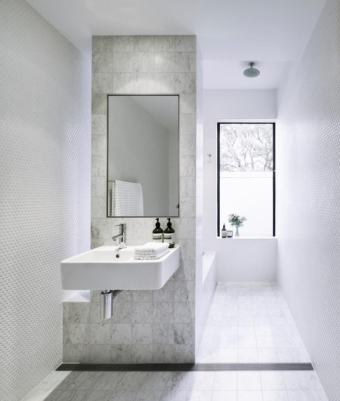 "Carrara marble tiles and white penny-round **tiles** from [Bisanna Tiles](http://bisanna.com.au/|target=""_blank""