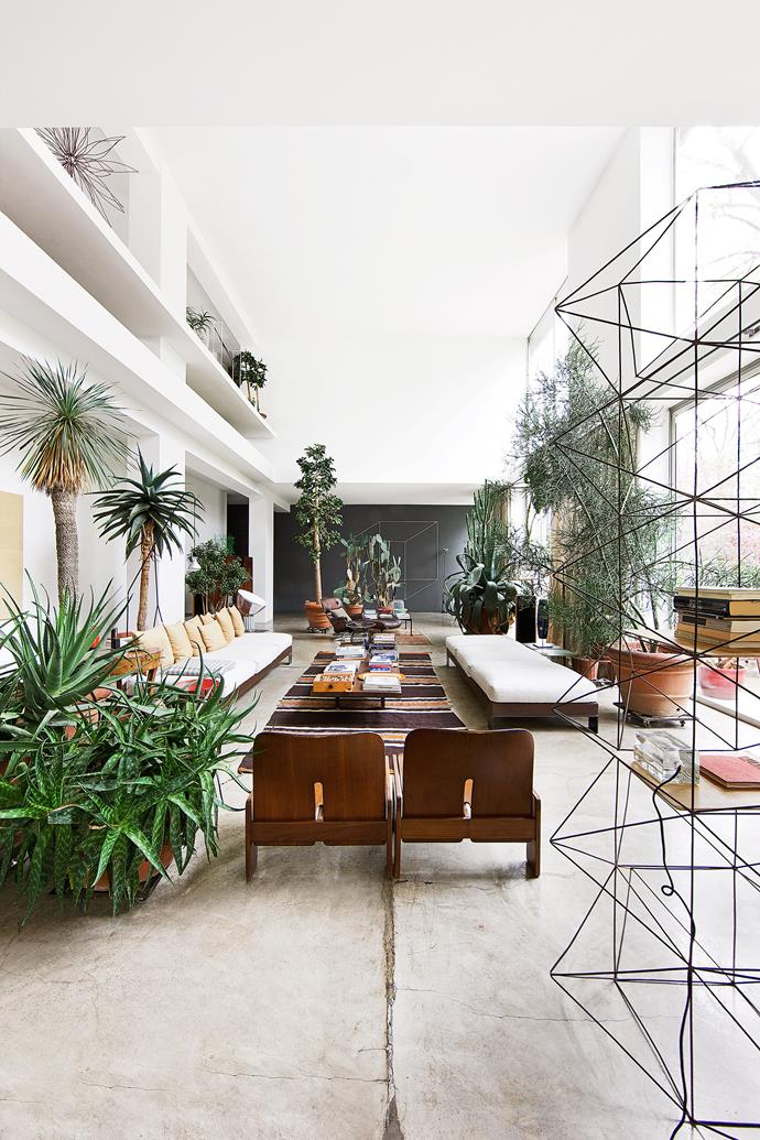 """The light-filled living area is also a perfect room to display Antonino's metal works. """"I live here but it is also my business address,"""" he explains. """"I wanted to make a place where interested people could see my creations on display, and possibly order them."""""""