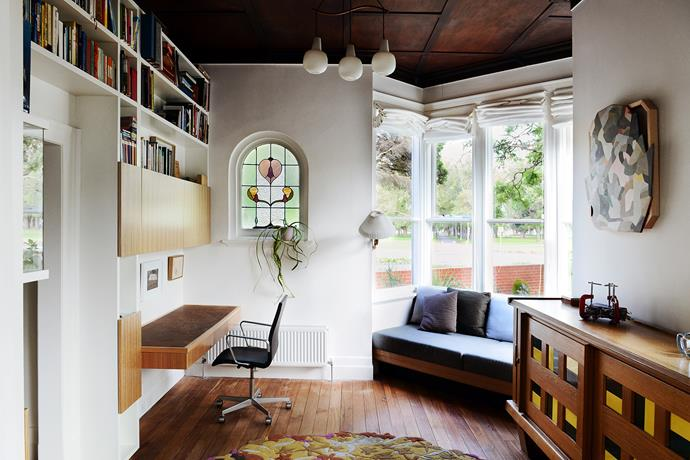 Built in the late 1800s, the home's grander front rooms that once served as formal living and sitting areas have been transformed into a casual, library-study zone adjoining the main bedroom.