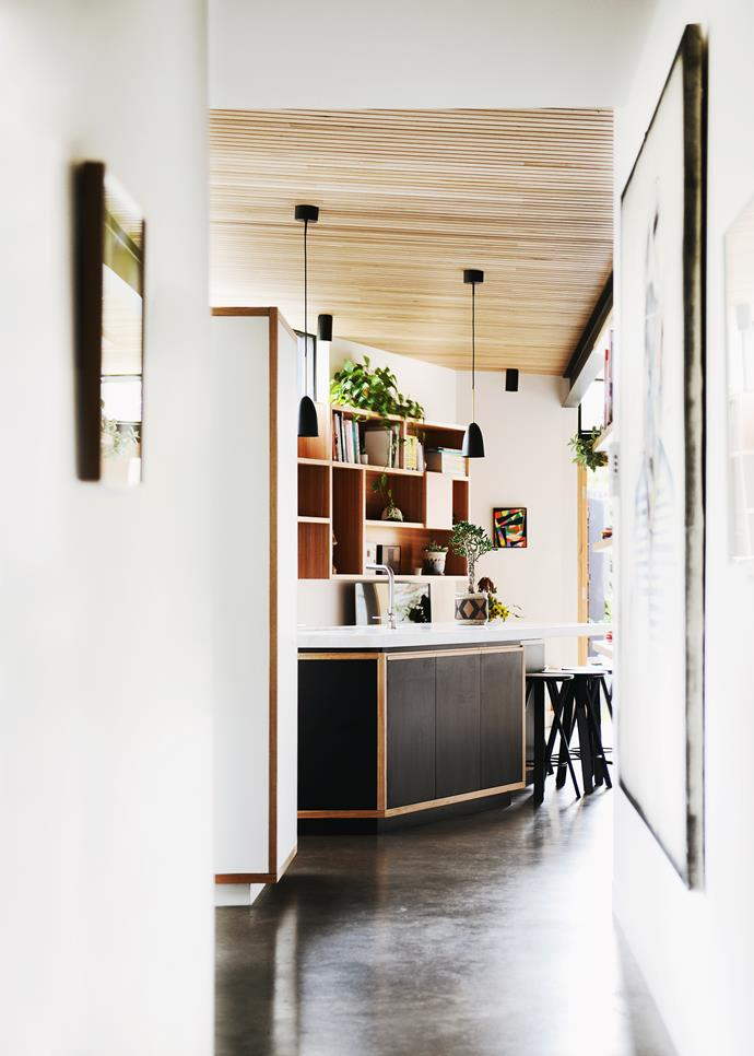 While this area employs heavier, more robust materials like a concrete floor and marble bench top, the ceiling is lined in silvertop ash in a shiplap profile to add texture and warmth.