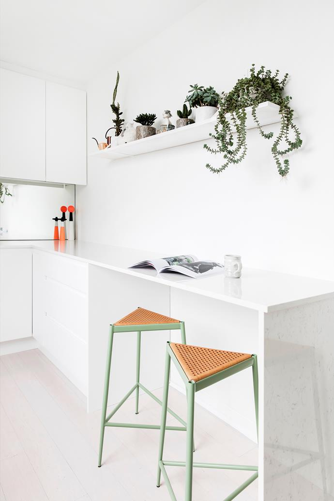 """""""We renovated the kitchen, laid floorboards and painted prior to moving in,"""" Elli says. The benchtops are Essastone, the Acciaio barstools are by Max Lipsey, available through [Cult](http://www.cultdesign.com.au/