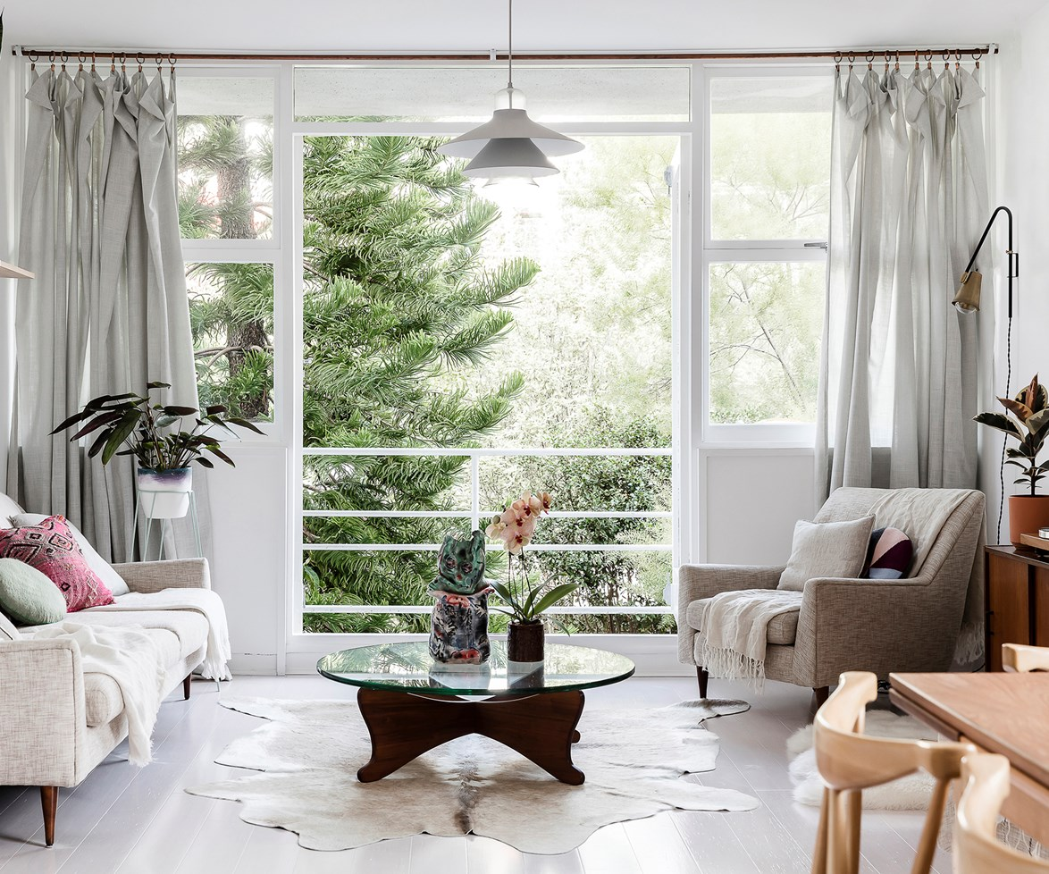 A leafy outlook is always a bonus when it comes to relaxing. The neutral palette combined with simplistic Scandi style gives off a zen-like vibe in this [Sydney apartment](http://www.homestolove.com.au/clean-and-fresh-apartment-renovation-4192). Photo: Maree Homer / real living
