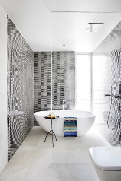 """Formerly home to Aussie supermodel, Jennifer Hawkins, it's no wonder why this bathroom shines with style. Floor to ceiling mosaics, a free-standing bath and a deluge of natural light turn this into a relaxing retreat. Photo via: [Domain](http://www.domain.com.au/18-molong-street-north-curl-curl-nsw-2099-2011145924  target=""""_blank"""" rel=""""nofollow"""")."""