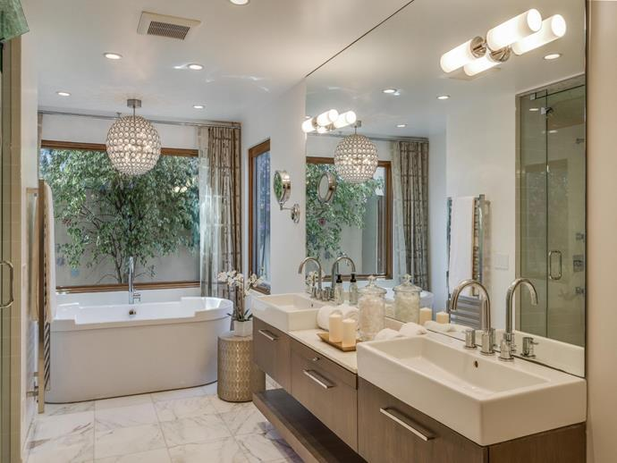 """Is that a disco ball in the bathroom? This Malibu pad was recently purchased for $3.5 million by Thor star, Chris Hemsworth and wife Elsa Pataky. This is only one of the four bathrooms in this 4,612-square-foot home with breath-taking views of the mountains and ocean. Photo via: [Sotheby's International Realty]( http://www.sothebysrealty.com/eng?gclid=CjwKEAjw-Oy_BRDg4Iqok57a4kcSJADsuDK1ucIsB44wB78_dINHW7VLlUC-SzeUrR8x74W_2_TczBoC-Jfw_wcB target=""""_blank"""" rel=""""nofollow"""")."""