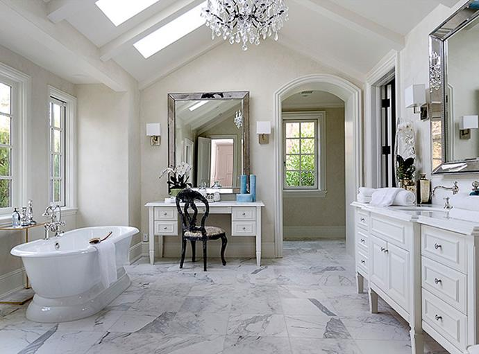 """Once home to Lisa Marie Presley, this bathroom now belongs to Kim Kardashian and Kanye West and is just one of eight in their Hidden Hills estate in California. This feminine bathroom is the 'hers' of the *his and hers* dual bathrooms off the master bedroom. Photo via: [Zillow]( http://www.zillow.com/ target=""""_blank"""" rel=""""nofollow"""")."""