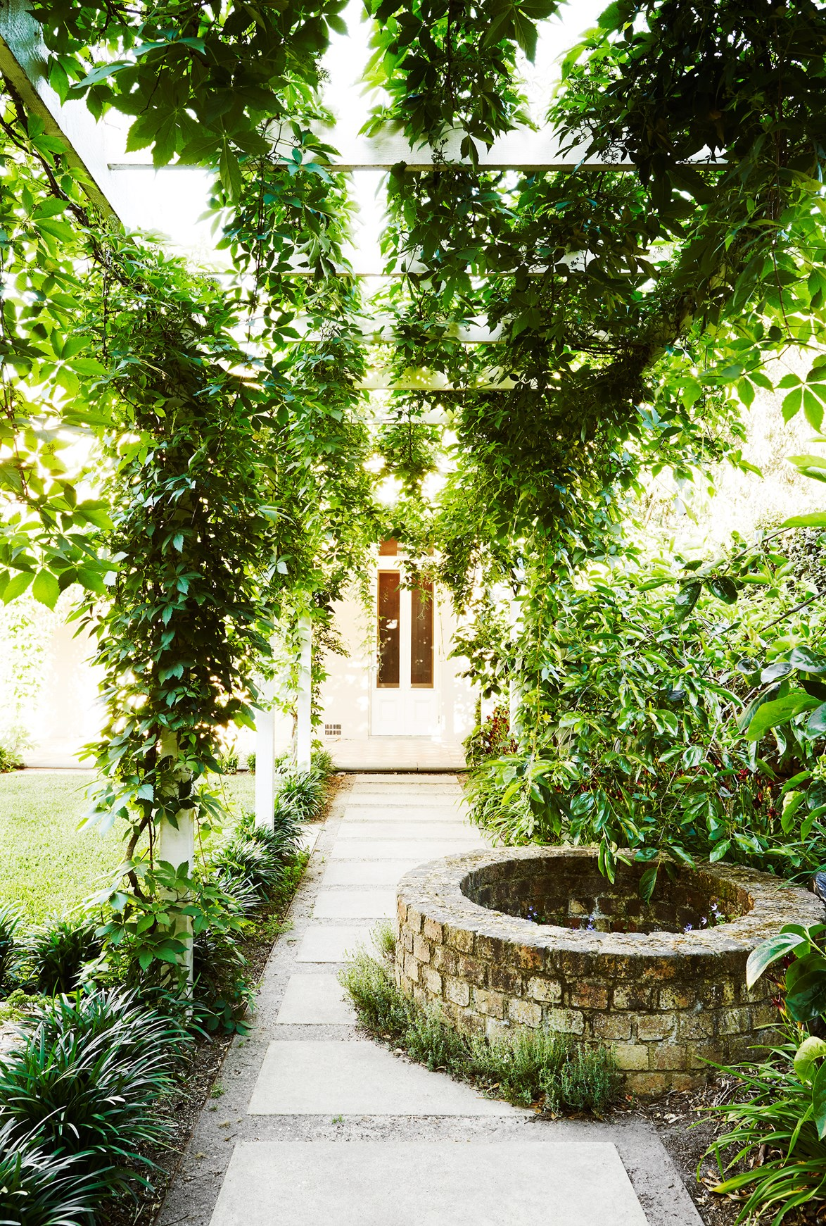 "For owners Marg and Rob, this [restored 19th Century garden](https://www.homestolove.com.au/19th-century-garden-restored-to-heritage-state-4210|target=""_blank"") has been a 30-year pursuit. The magnificent garden features an ever-changing display of fragrant roses, azaleas, lavender and camellias along with citrus trees, potted herbs and strawberries."
