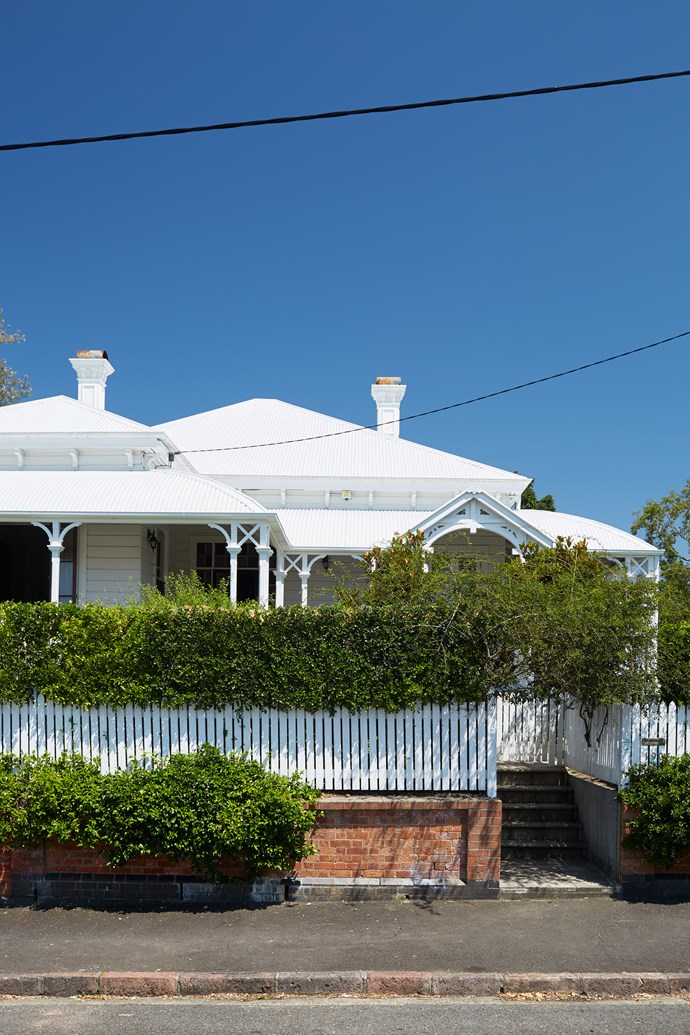 """The home's Queenslander style was a big drawcard for Patricia. """"Its elevated position offers views to the horizon,"""" she says. Hedges of evergreen Murraya paniculata and deciduous May bush provide privacy from the street and flush with scented white flowers come spring."""
