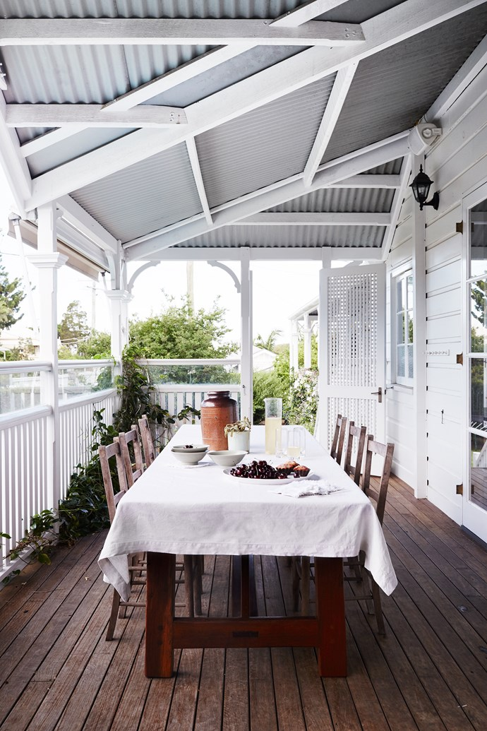 The verandah off the kitchen is a favourite spot to enjoy breakfast or morning tea. The custom-made table is accompanied with well-suited secondhand chairs.
