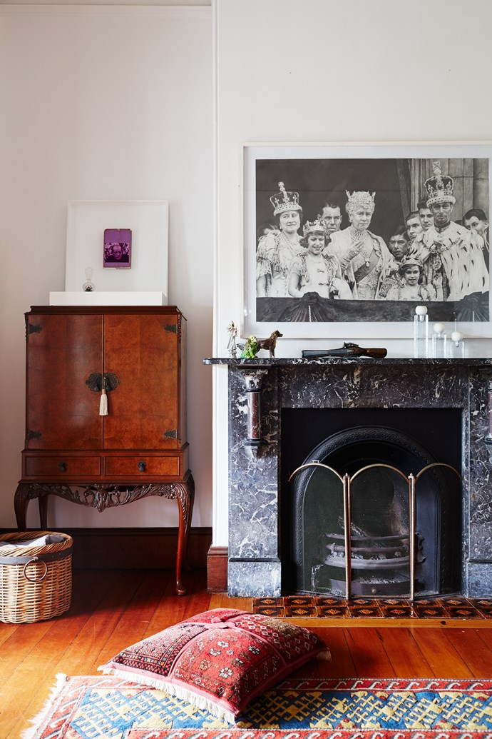 Antique Liberty of London drinks cabinet sits seamlessly next to the existing fireplace. Paintings by Chris Bond (above cabinet) and Sam Cranstoun (above mantel).