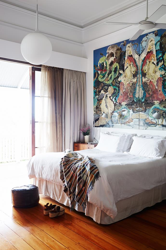 The home's 3.8m ceilings are a distinct advantage when it comes to hanging artworks, such as this painting by Ben Quilty in the main bedroom.