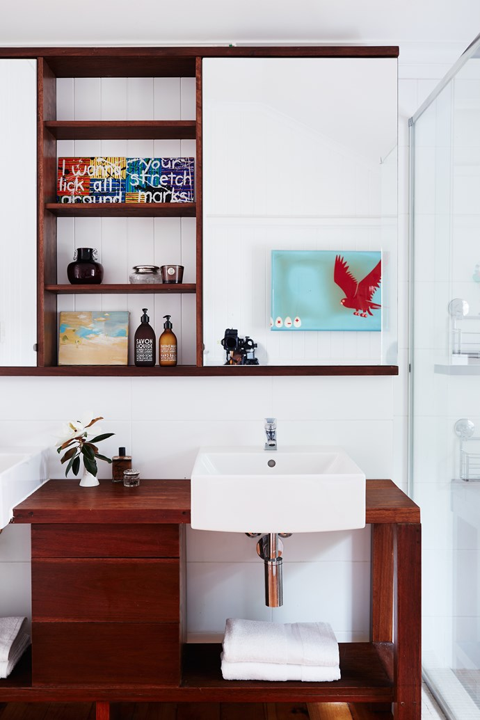 """A custom-made vanity and open shelves solved a space issue in the girls' bathroom. Basin, [Villeroy & Boch](http://www.villeroy-boch.com.au/