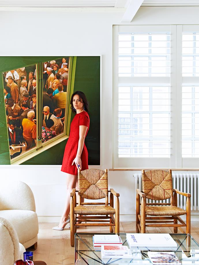 """A large photo artwork by Alex Prager is a focal point in the living area. """"I remember thinking how original and beautiful it was,"""" says homeowner Alex Eagle, pictured."""